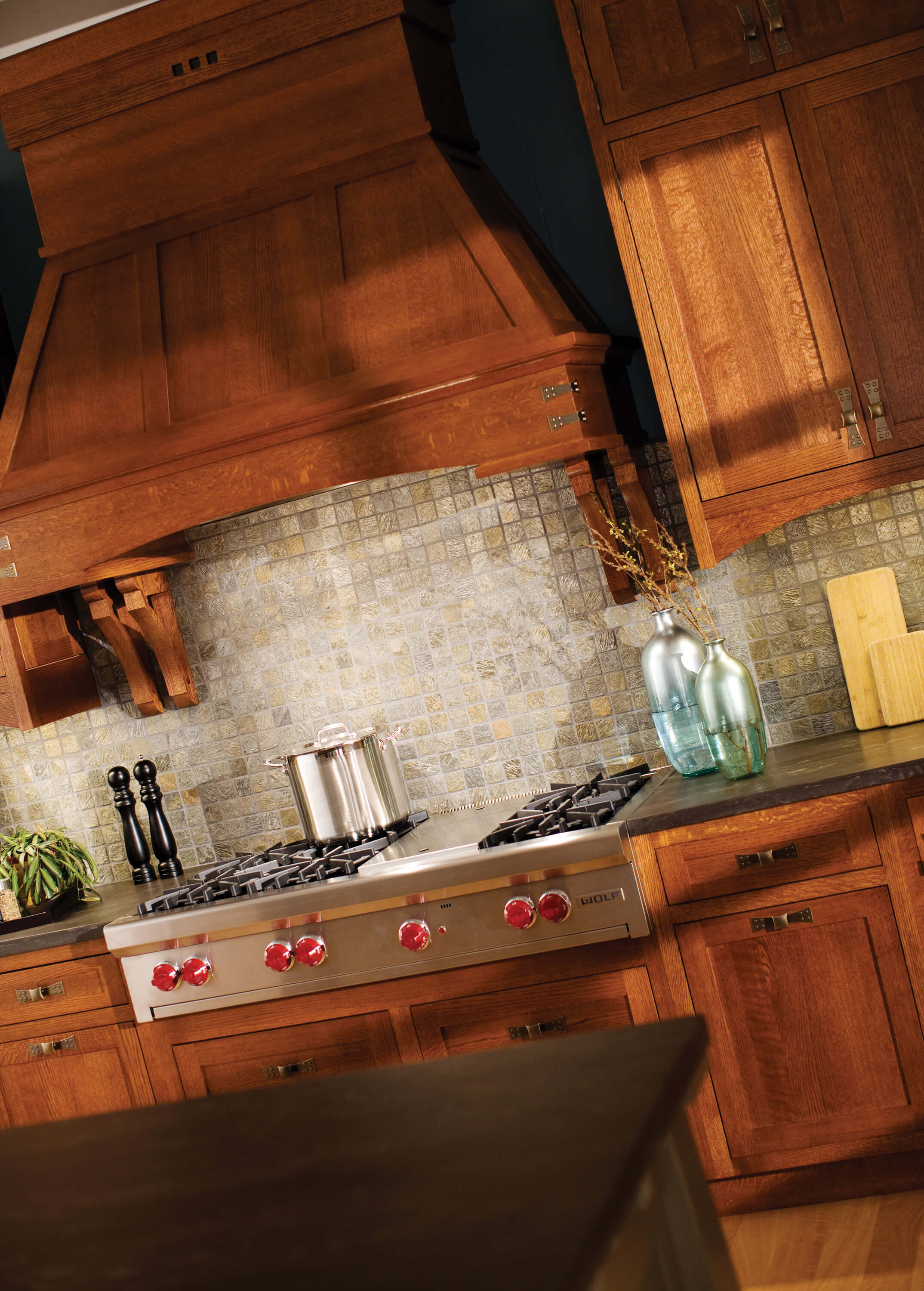 Wood hoods add a true hand-crafted focal point to a Craftsman style kitchen design.