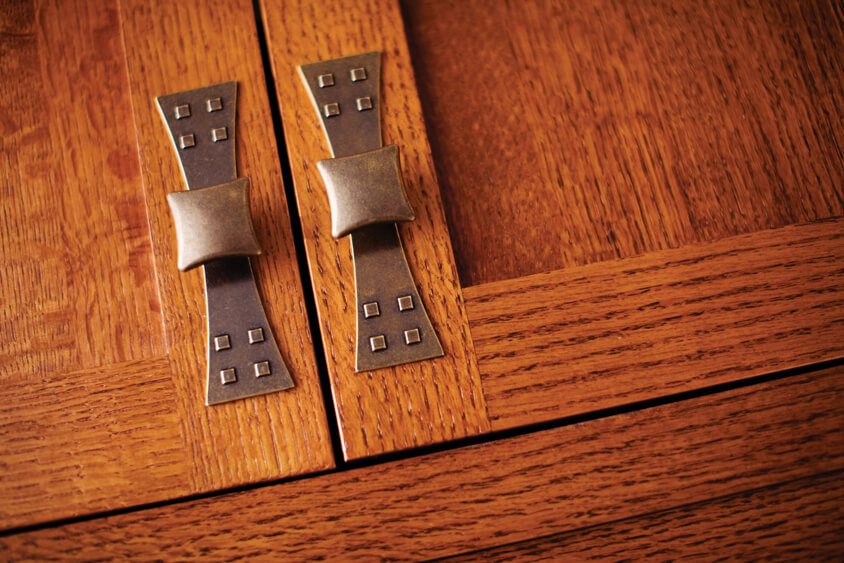 Seek cabinet hardware with a recognizable Craftsman-era embellishment are used to go with with craftsman style of this cabinet door.