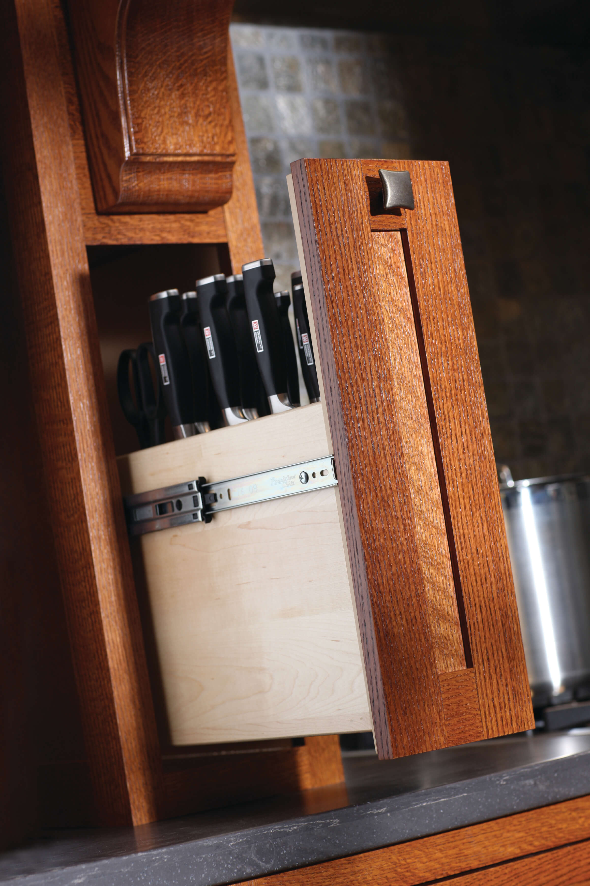 Interiors of cabinets commonly feature customized, well-thoughtout storage solutions like this wood hood pull-out for cuterly.