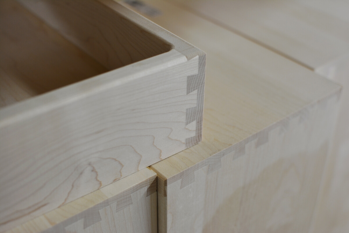 A cabinet drawer box with sleek dovetail joinery from Dura Supreme Cabinetry.
