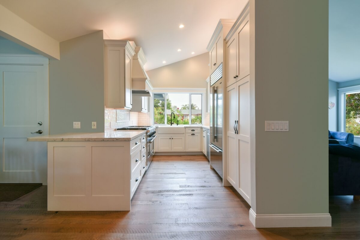 Cabinet and wall lengths can vary in size on a U-shape kitchen design. This beautiful kitchen design showcases a great example of how the U-shape design can be flexible and tailored to each space.