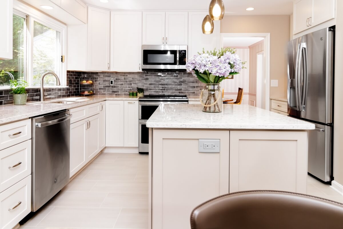 An example of a charming bright white U-Shaped kitchen designed by House to Home Solutions.
