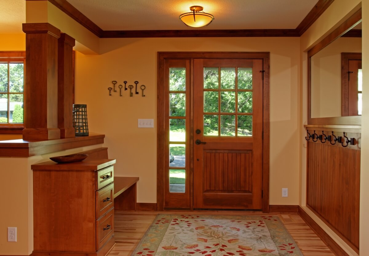 A Craftsman styled entryway with a built-in Dura Supreme boot bench. Design by Kristen Peck of Knight Construction Design, Inc., Minnesota.