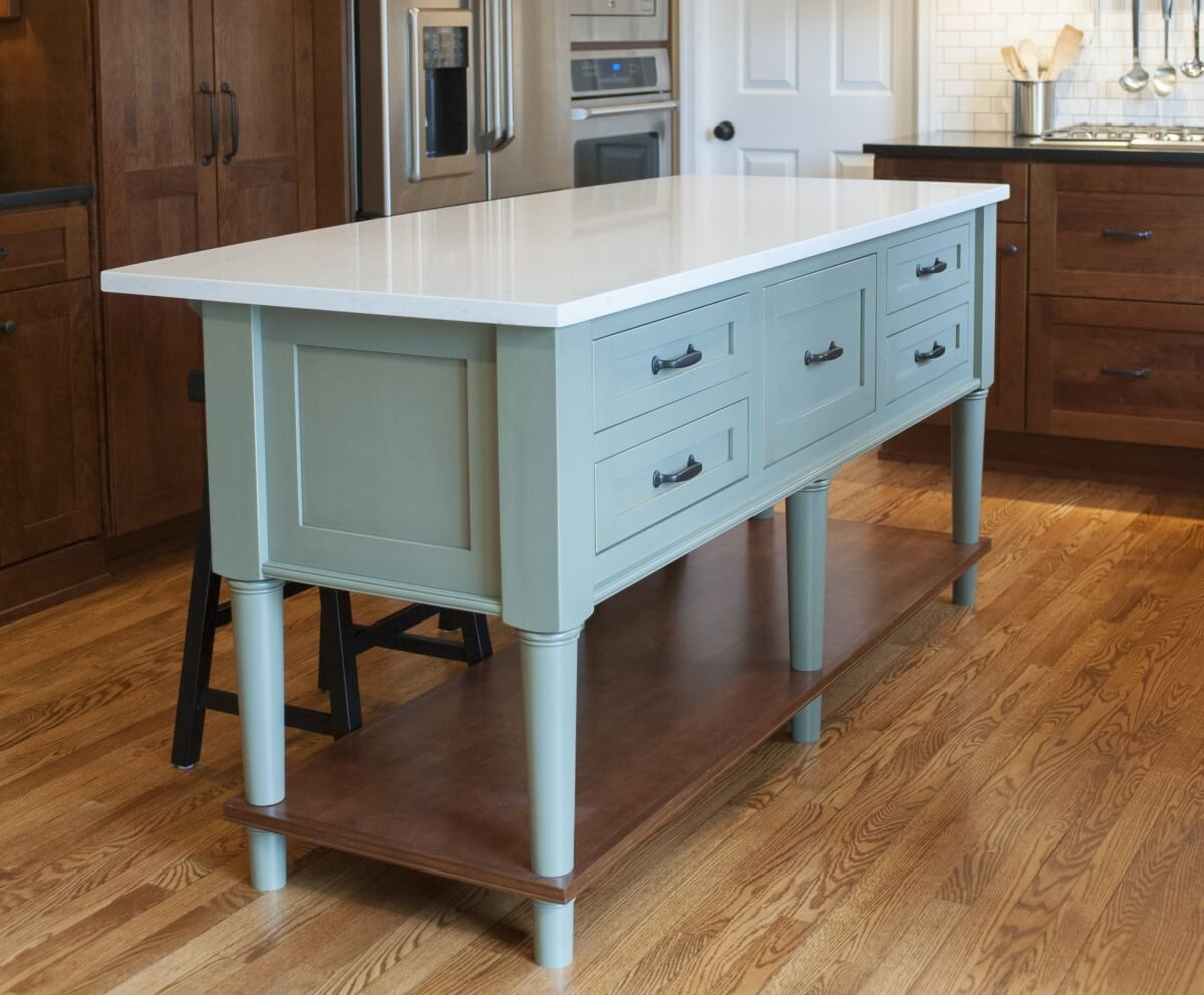 Design features like kitchen islands for example, tend to have a more furniture-styled look. Dura Supreme Cabinetry design by The Kitchen Studio at Pine Street Carpenters Inc.