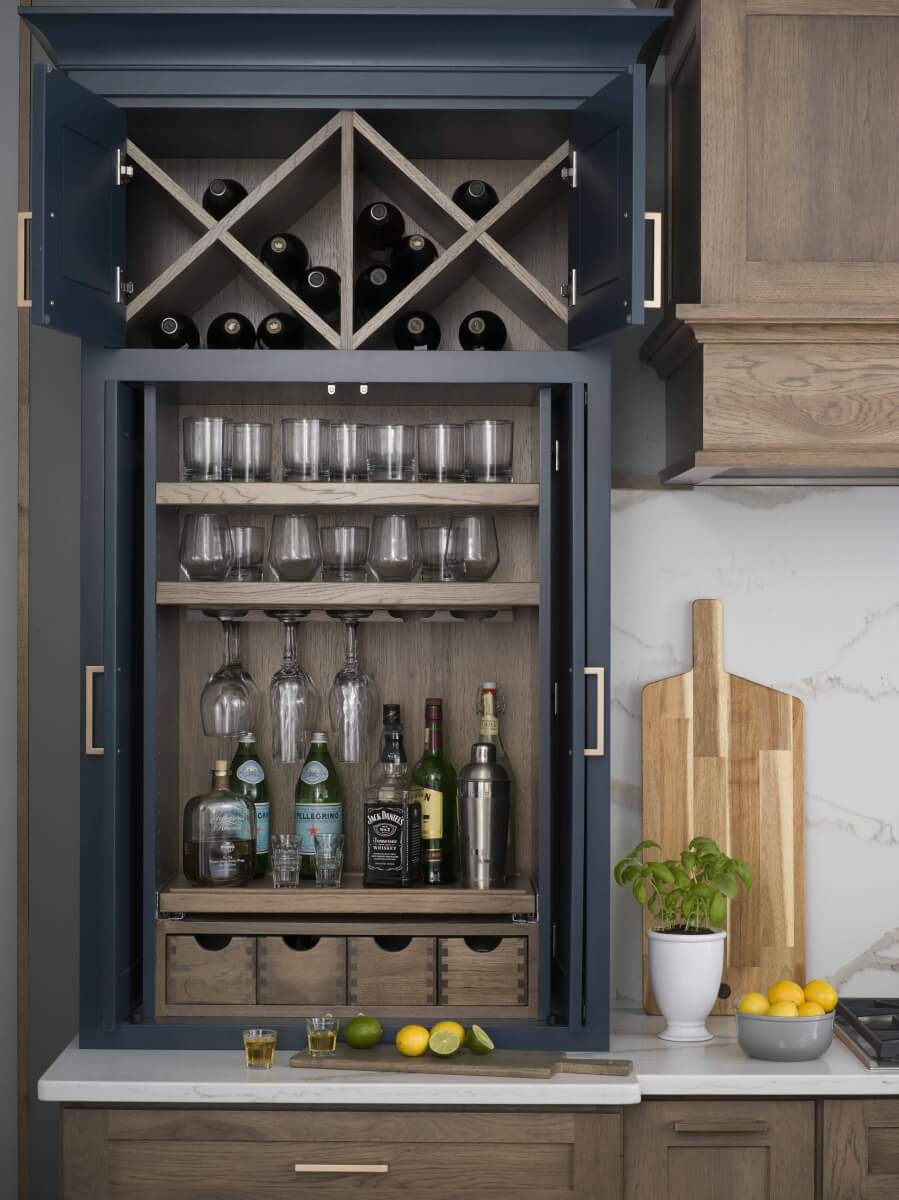Dura Supreme Cabinetry Beverage Center Larder shown used for home bar storage.