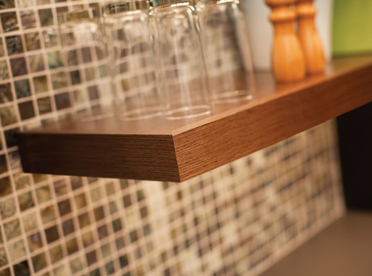 Floating shelves maintain an open, airy look which Urban Loft interior designs are known for.