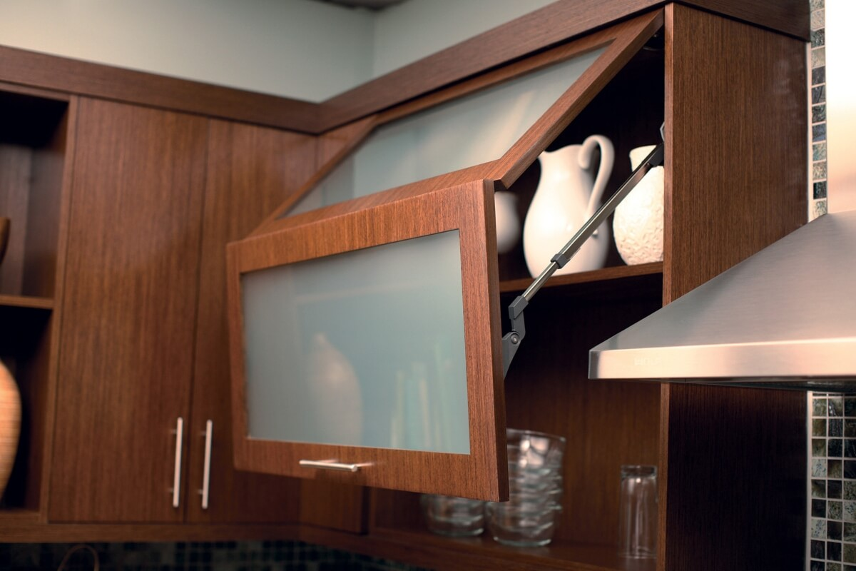 Horizontal bi-fold cabinet doors are a popular choice in lofty kitchens. Dura Supreme Cabinetry in a an Urban Loft Style design.