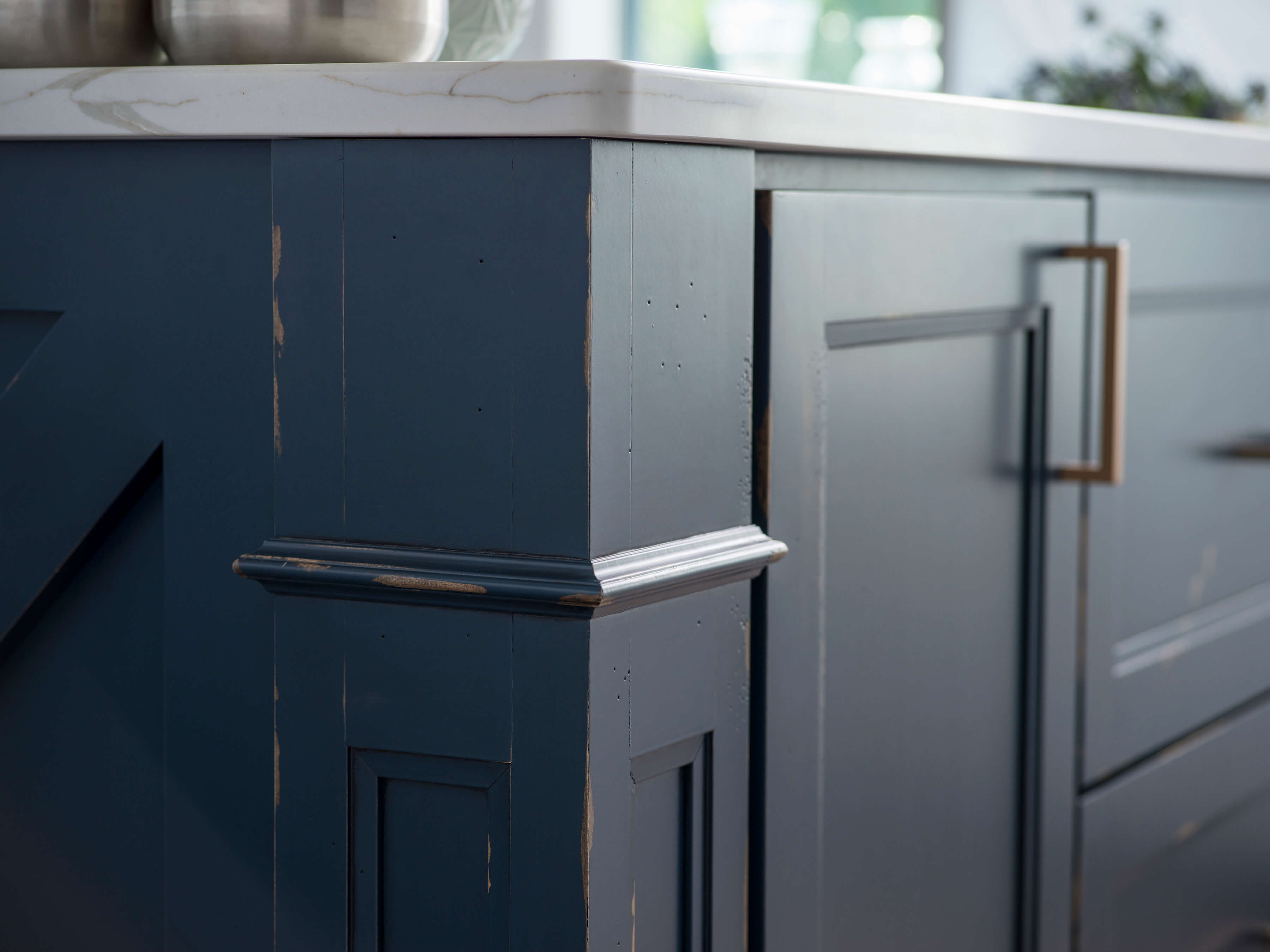 A kitchen island with a beautiful distressed paint finish with Dura Supreme's Heritage Paint finish in a custom Navy blue color.