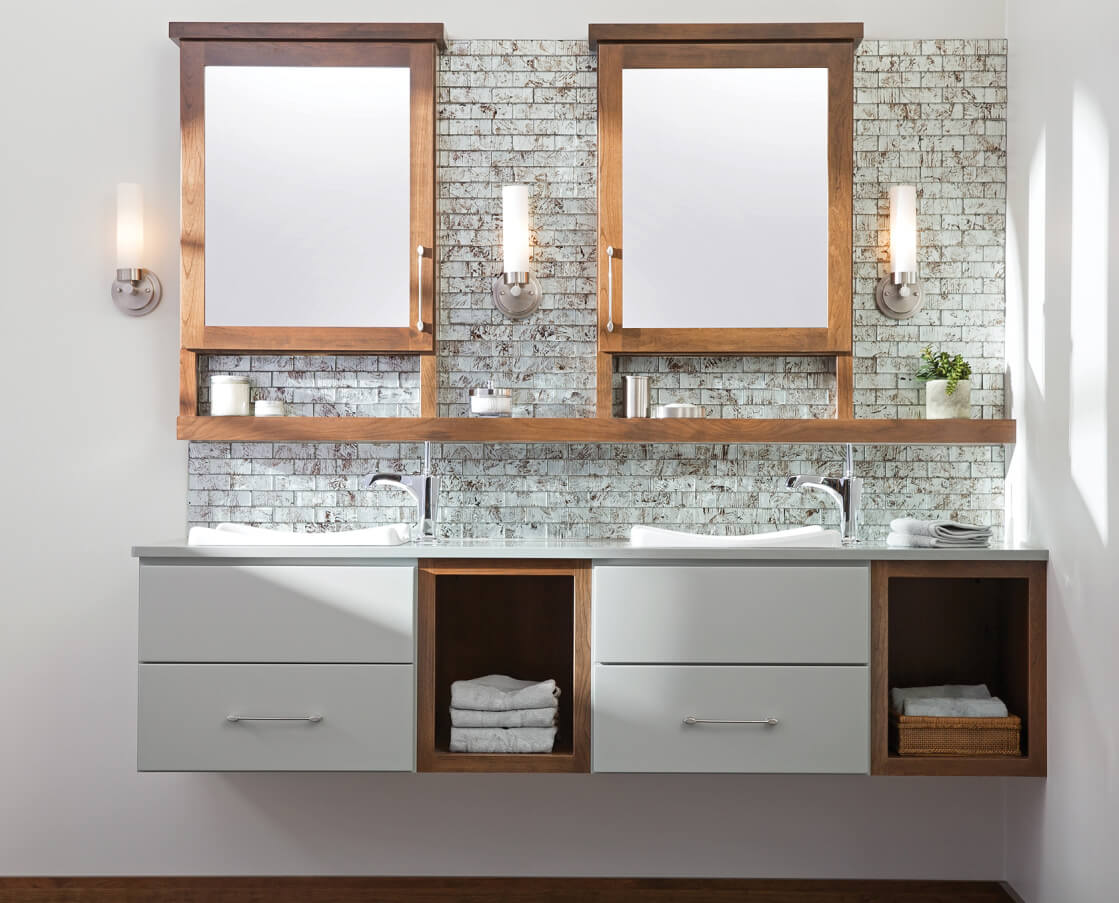 Floating vanity with wall hung bathroom cabinets from Dura Supreme Cabinetry.