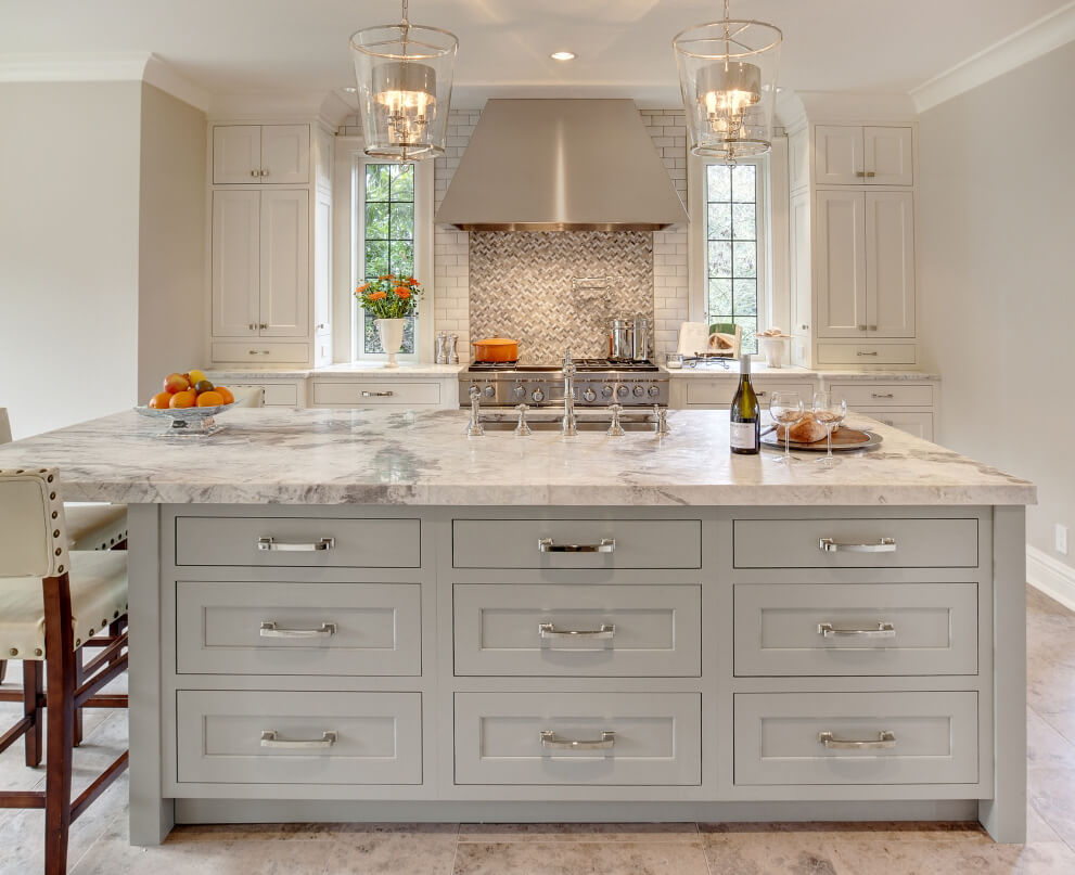 Gray painted kitchen island with off-white painted perimeter cabinets. This warm and bright kitchen combines white and gray finishes beautifully.