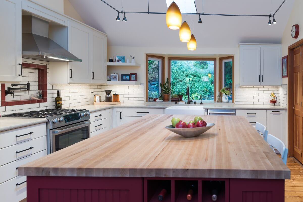 White and barn red color palette in a modern farmhouse kitchen design.