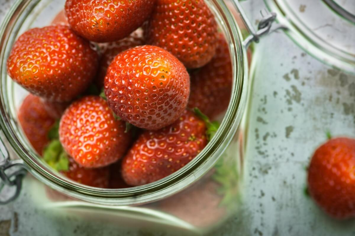 A close up of fresh picked strawberries for canning jams. A kitchen remodel designed for canned goods.