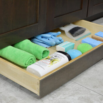Miscellaneous items can find a home in a Dura Supreme Toe-Kick Drawer hidden at the foot of your cabinets. It is the perfect place for stashing cleaning supplies to they're out of the way, yet close at hand.