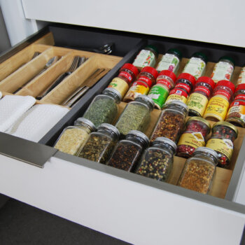 Dura Supreme's wood Drawer Spice Rack can be used in combination with our stainless steel drawer options.
