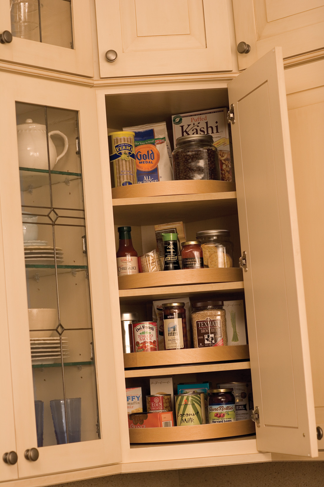 Kitchen Corner Cabinet Storage Ideas from Dura Supreme Cabinetry. A corner lazy susan in a wall cabinet.