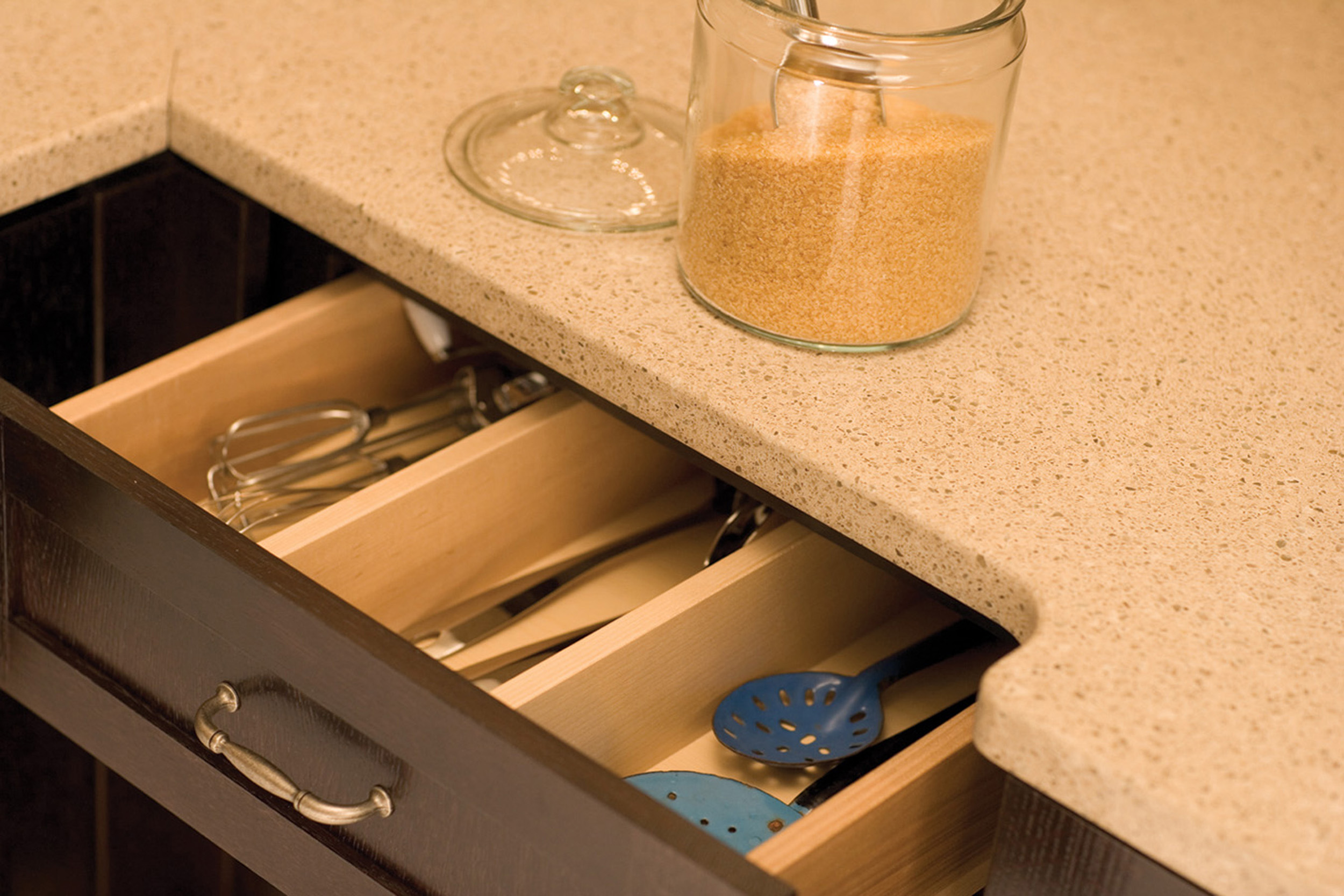 Drawer partitions can be specified to divide a drawer based on your personal preferences. Kitchen Drawer Storage from Dura Supreme Cabinetry.
