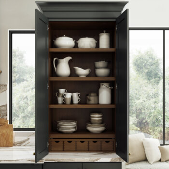 Dura Supreme Cabinetry Storage Larder shown used for dishware.