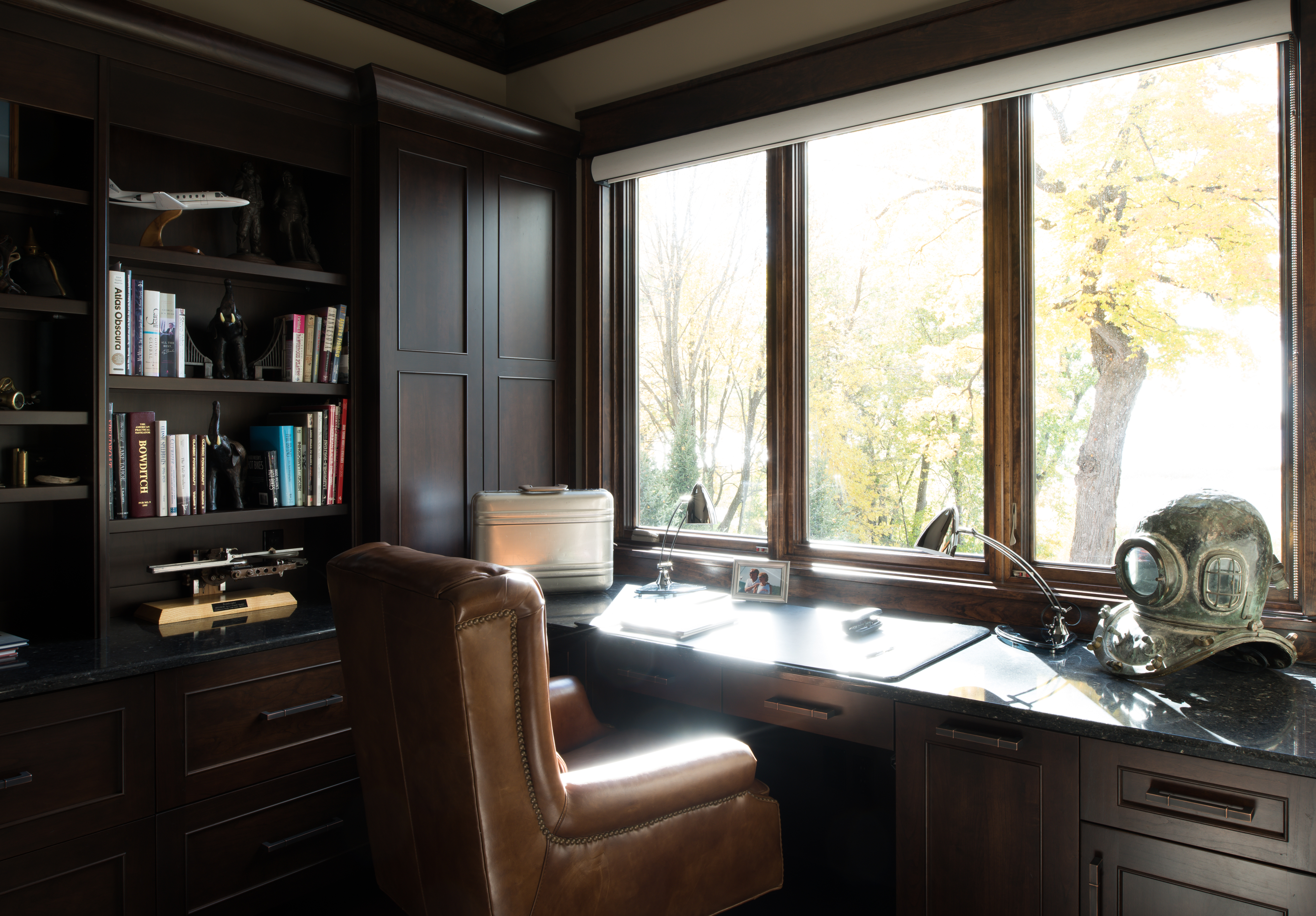 A traditional, formal home office design with a little industrial steampunk styling.