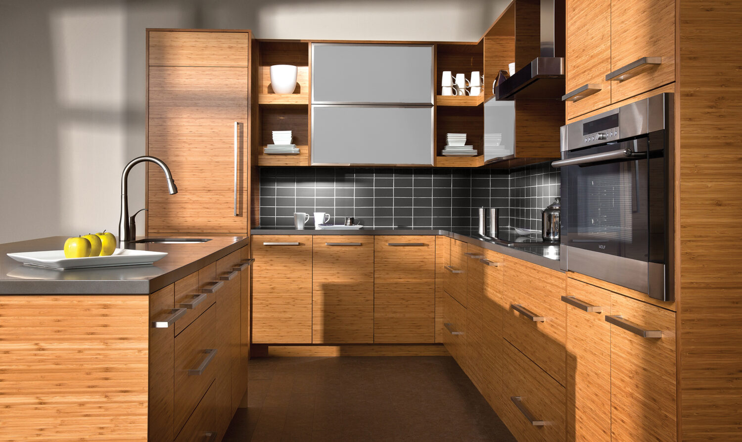 A contemporary style kitchen with warm bamboo cabinets from Dura Supreme Cabinetry.