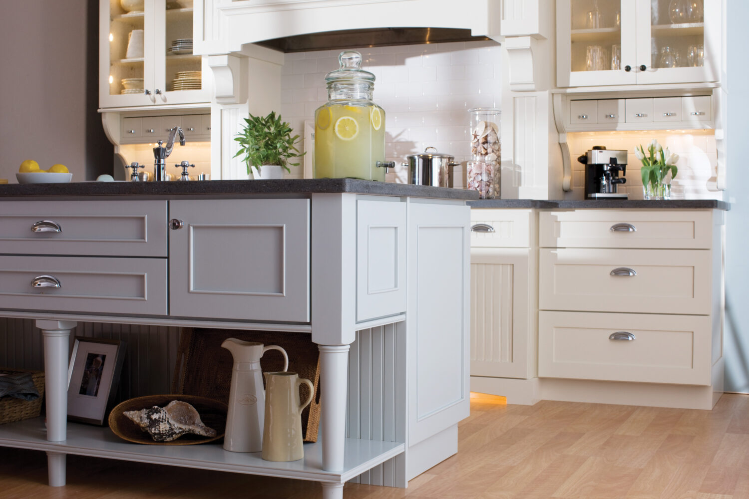 This cottage styled kitchen design mixes 3 door styles. Mixing Dura Supreme's Craftsman Panel and Craftsman Beaded Panel for the perimeter and Silverton on the kitchen island.