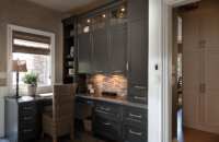 Dura Supreme Cabinetry finished in Graphite paint w/Shadow Glaze on Arcadia door style, Design by Studio M Kitchen & Bath, Plymouth, MN.