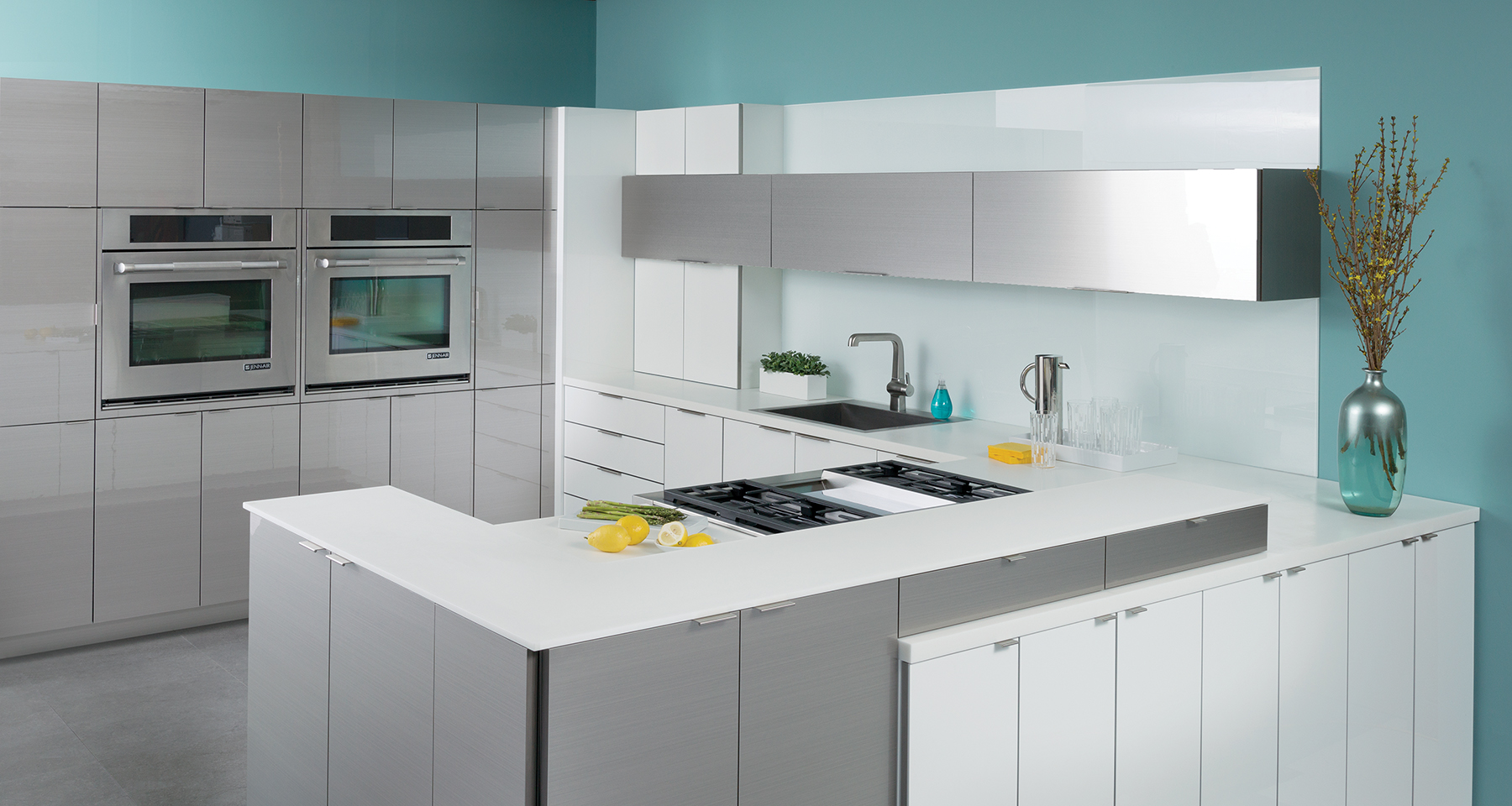 A modern kitchen design with glossy and contemporary cabinets the look similar to stainless steel and white high gloss acrylic cabinets.