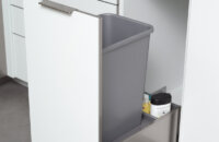 Stainless Steel metal Pul-out Cabinet for a Waste Basket. Kitchen Cabinets and storage from Dura Supreme Cabinetry.