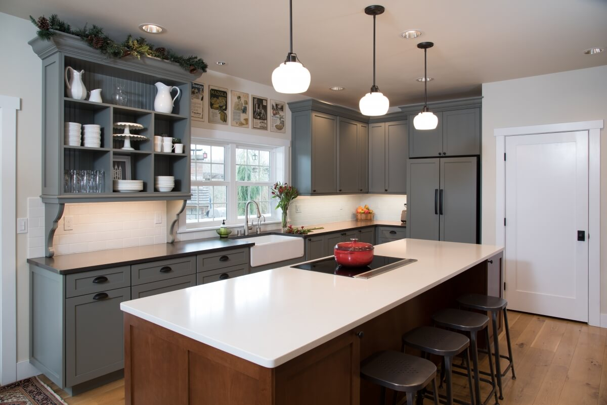 Dura Supreme kitchen by designer Molly McCabe at A Kitchen That Works LLC showing recommended landing space behind cooktop in an island.