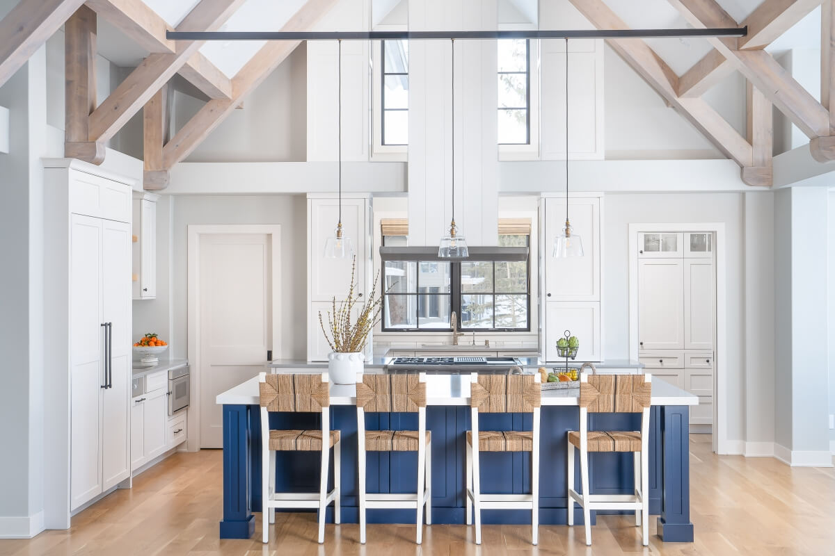 This bold and beautiful kitchen island will captivate all who enter this modern farmhouse home with Dura Supreme Cabinetry.