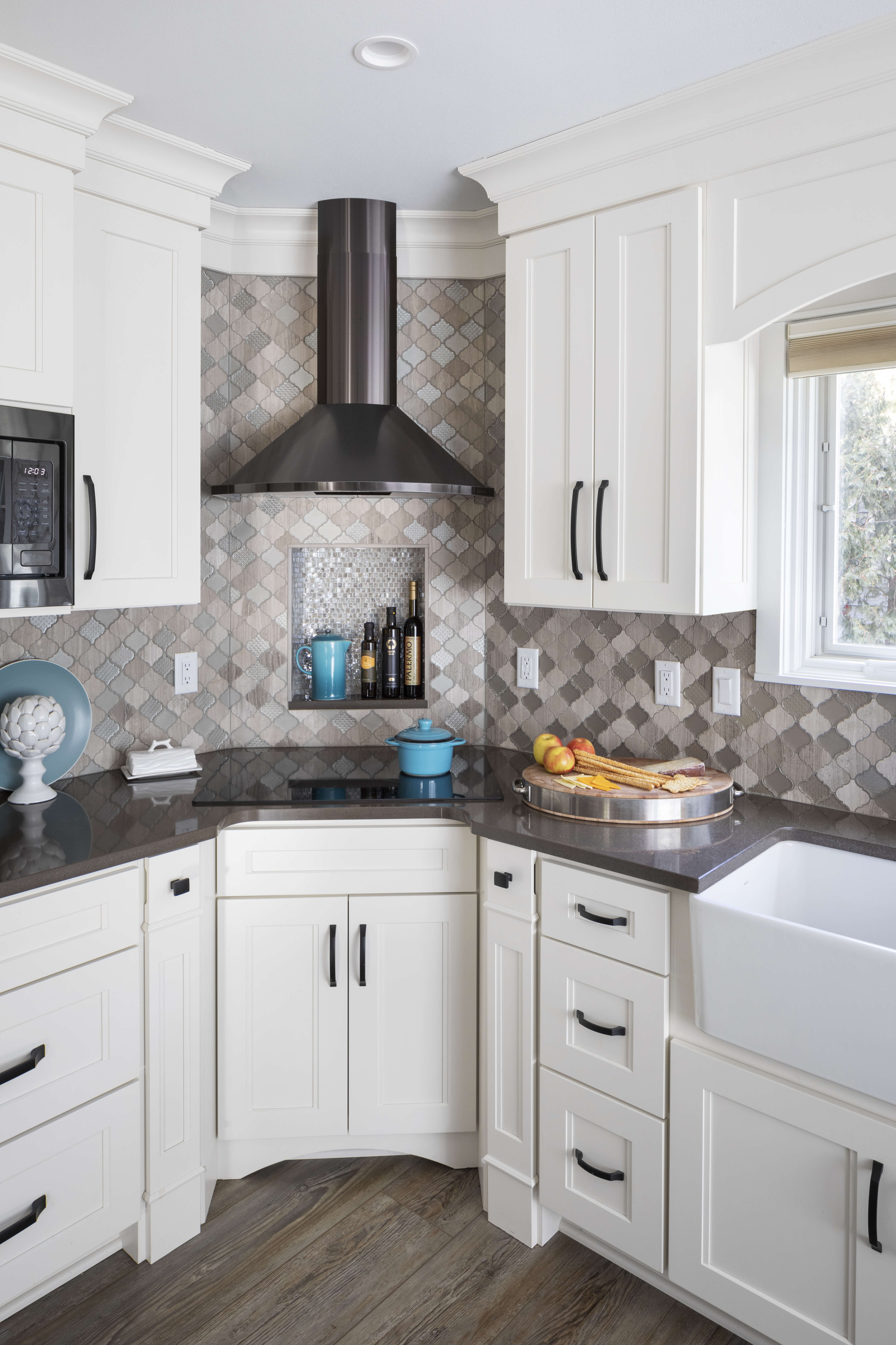 A kitchen remodel with a corner range that is tucked back.