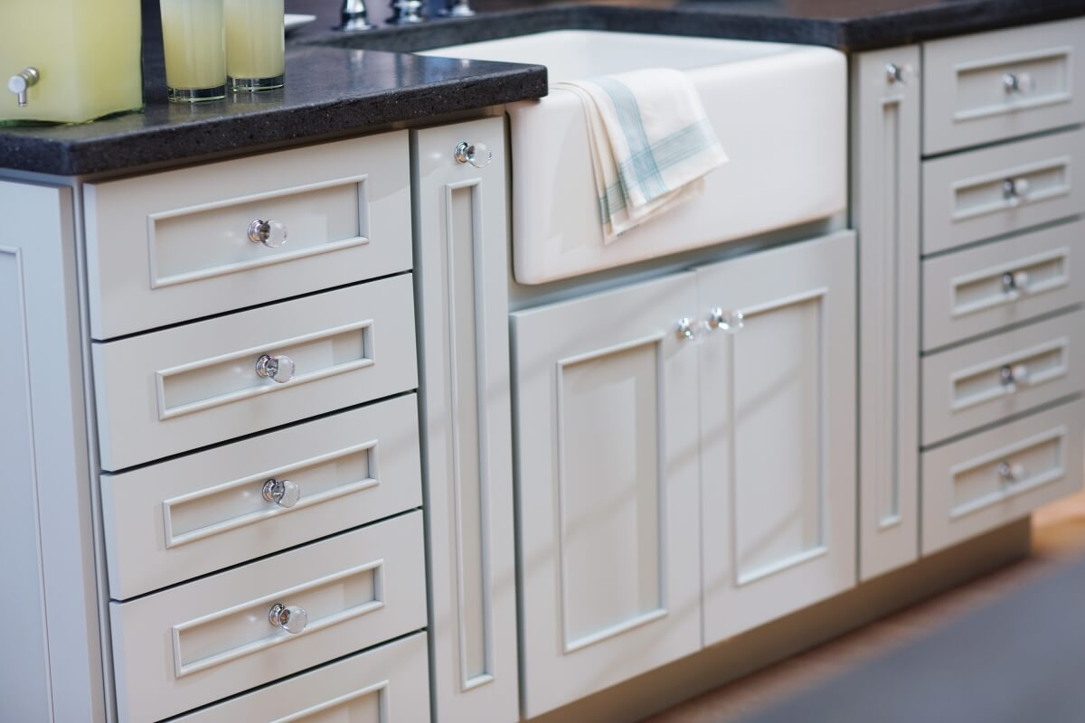 A light blue painted kitchen island in a cottage styled kitchen in a remodeled country home.