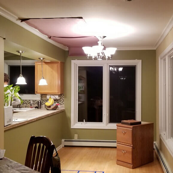 Kitchen makeover story. Before photo of the window where the designer put the new window seat and home office storage cabinets.