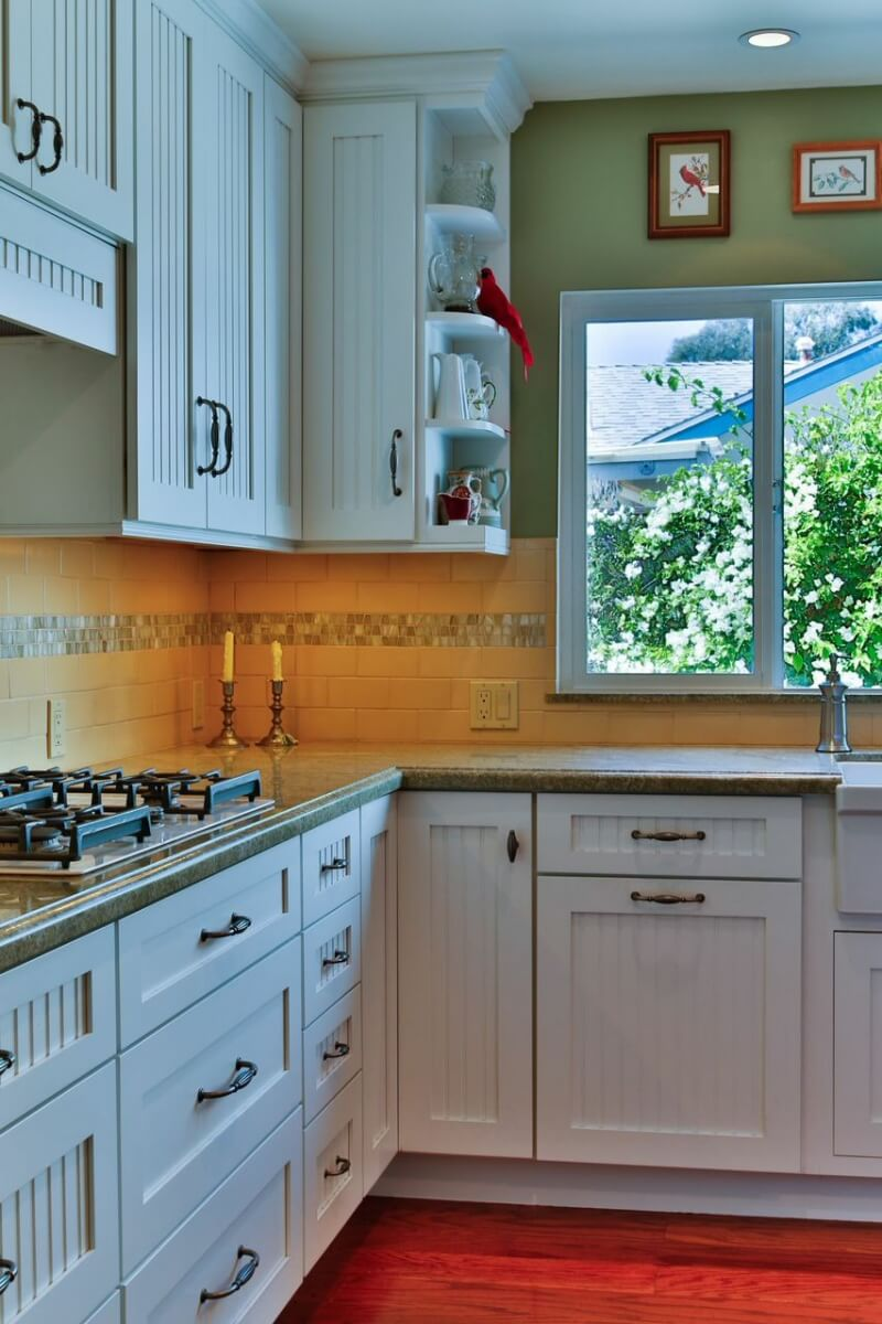A cottage styled kitchen with a corner wall cabinet and a corner base cabinet with Dura Supreme Cabinetry.