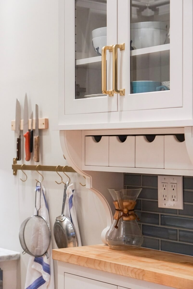 A shallow, hutch-like space catches your eye as you step into this kitchen.