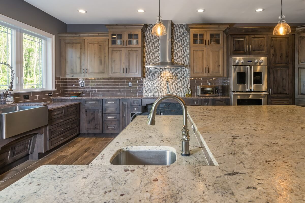 Counter Height Vs Bar The Pros Cons Of Kitchen Island Seating Styles Dura Supreme Cabinetry
