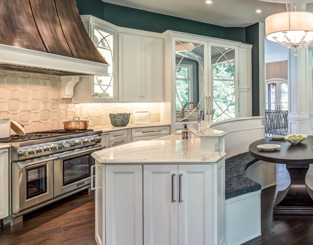 A grand kitchen design with mullion cabinet doors and a refrigerator with mirrored mullion doors to match the decorative cabinet doors. Dura Supreme kitchen design by Aaron Mauk of Mauk Cabinets by Design, Ohio.
