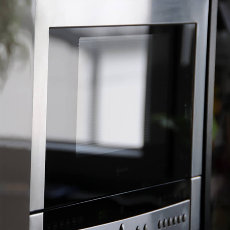 Close up of a modern day microwave. History of Kitchen Design and Where should the microwave go?