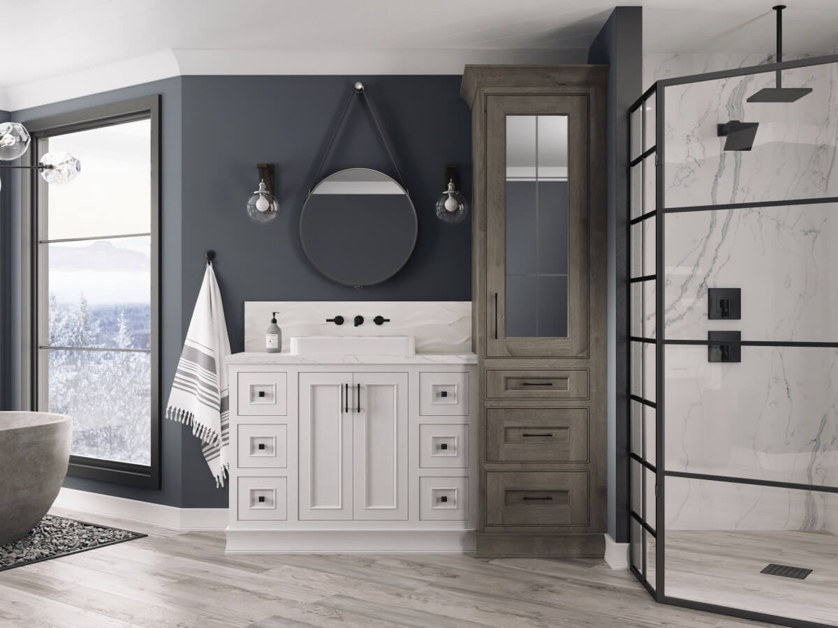 A wintery gray and white bathroom design with a leaded glass mirror cabinet door.