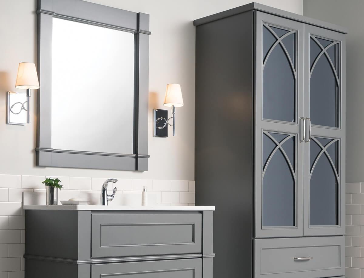 Dark gray bathroom furniture and vanity cabinets with delicate mullion cabinet doors with a dark gray mirror cabinet door insert.
