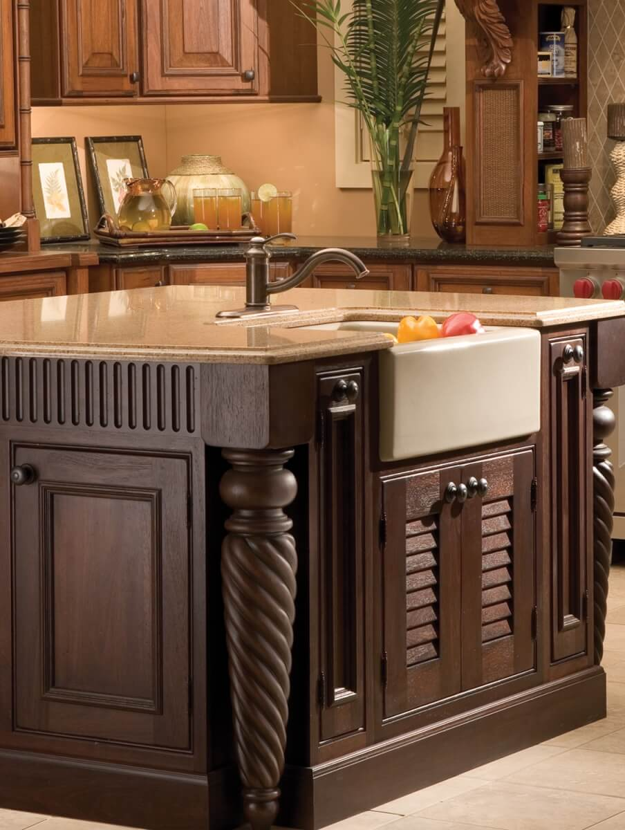 A traditional furniture-styled kitchen island with decorative turned posts and well-planned molding can create a centerpiece for your tropical-inspired kitchen.