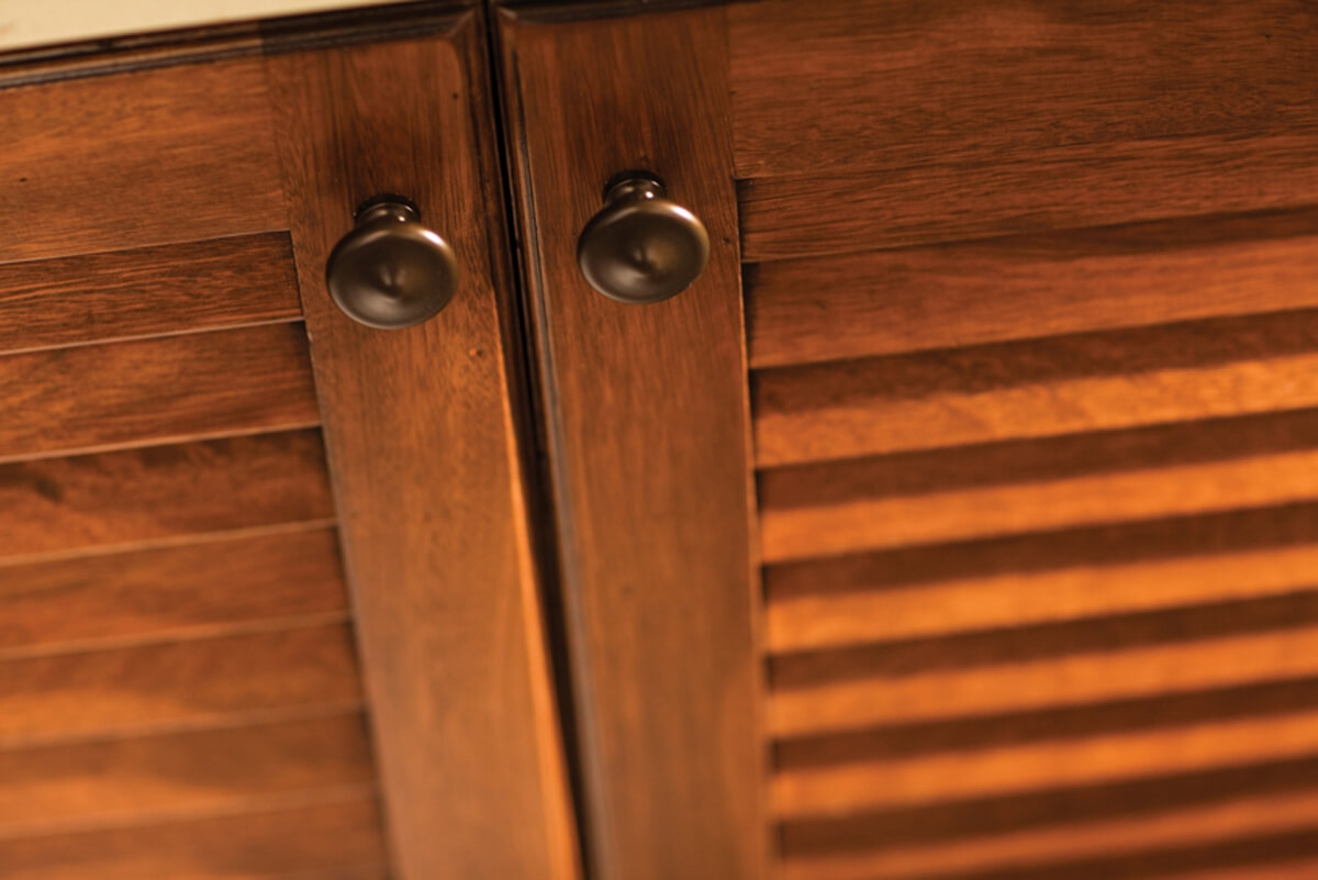 Louver cabinet doors and rattan can be used as accents to create texture and interest. They are a great option for promoting airflow in areas like under a sink or in a bathroom.