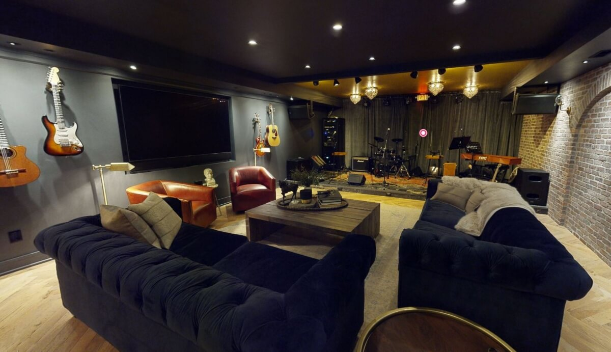 A basement remodel with a stage for musical performances.