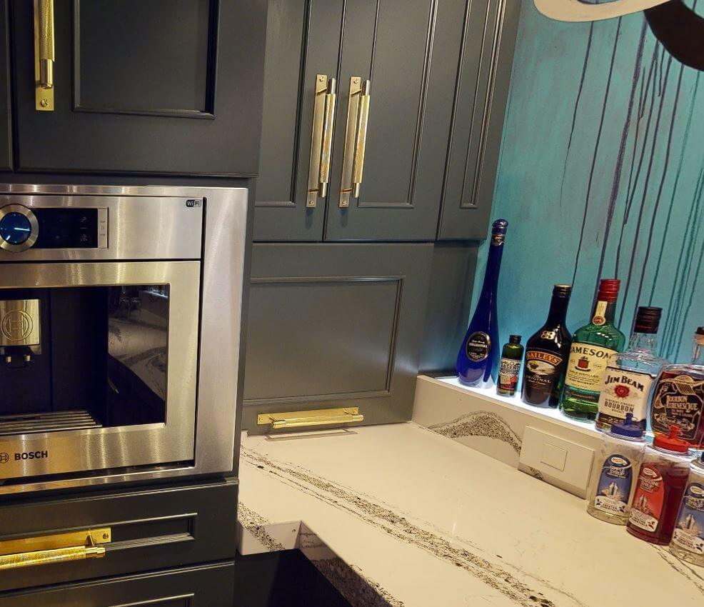 A close up view of the lift-up cabinet that stores the countertop appliances for the working bar.