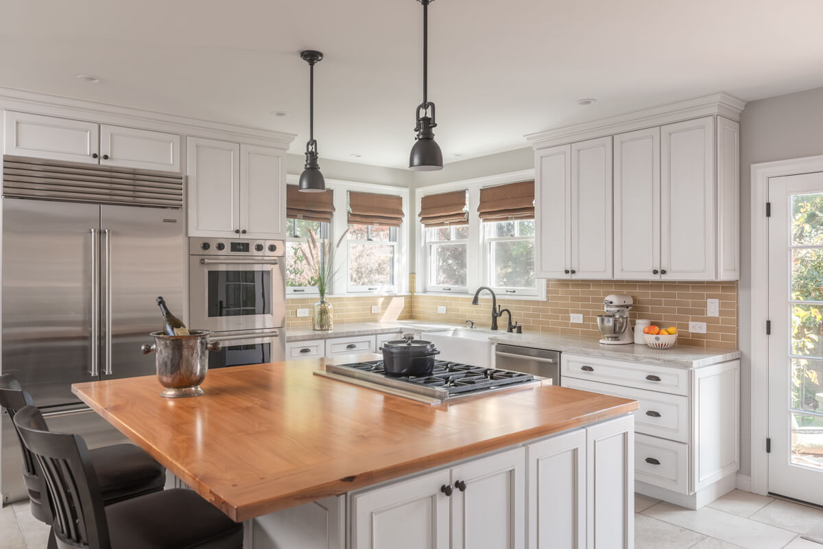 A classic kitchen design with white painted cabinets and beautiful styling.