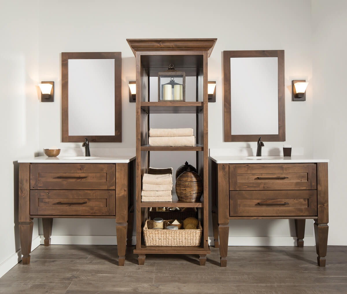 A master bathroom with double vanities featuring a tall freestanding linen cabinet with a mirror in the back of the cabinetry.