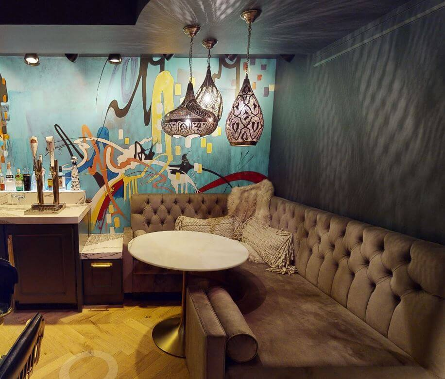 A built-in booth next to the entertainment rooms wet bar provides a VIP like experience to guests.