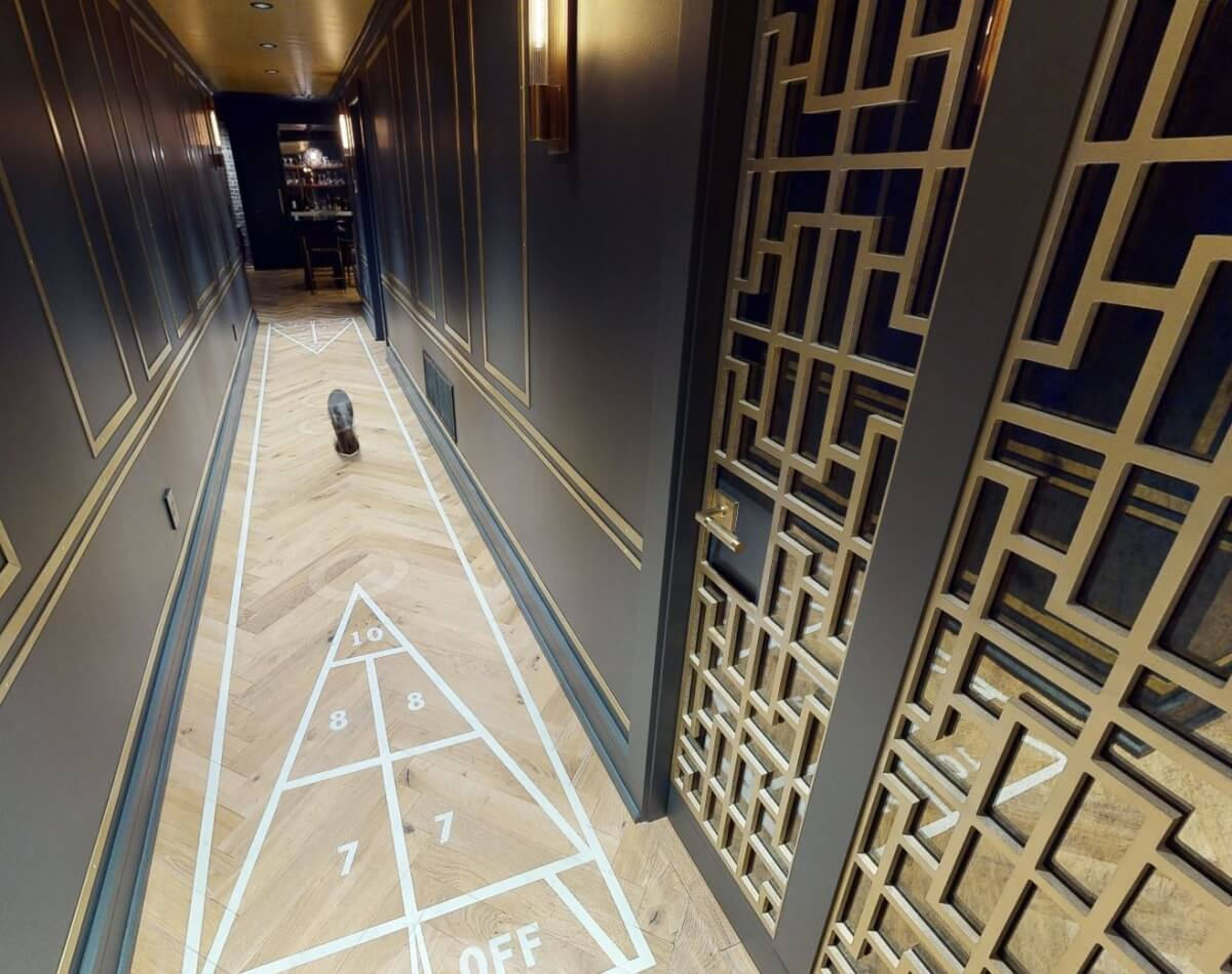 A Shuffleboard game was incorporated into the hallway flooring to offer a fun use of the space.