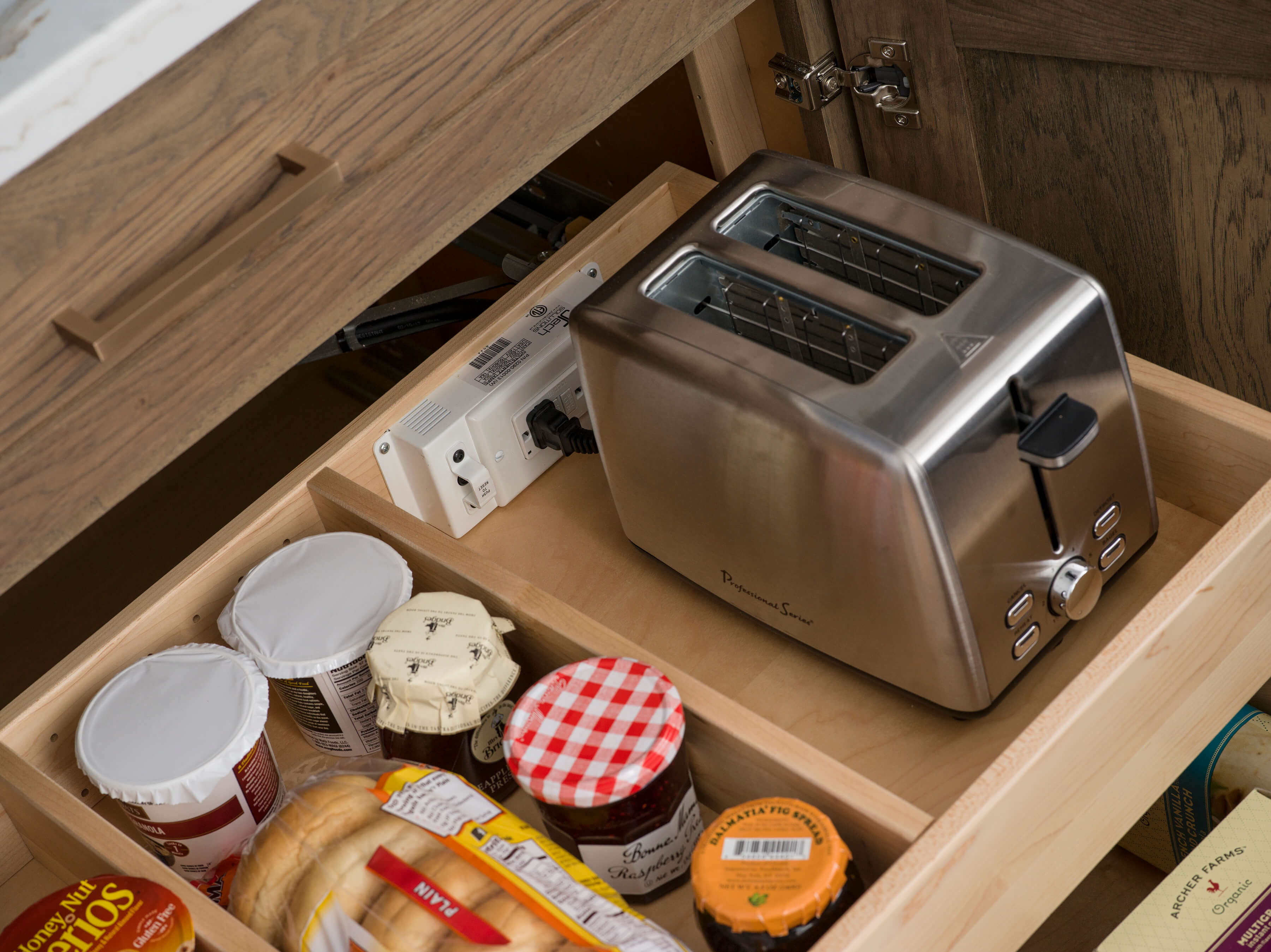 Roll-out shelves within a cabinet can be outfitted with a Dura Supreme power station or charging station for a variety of uses.