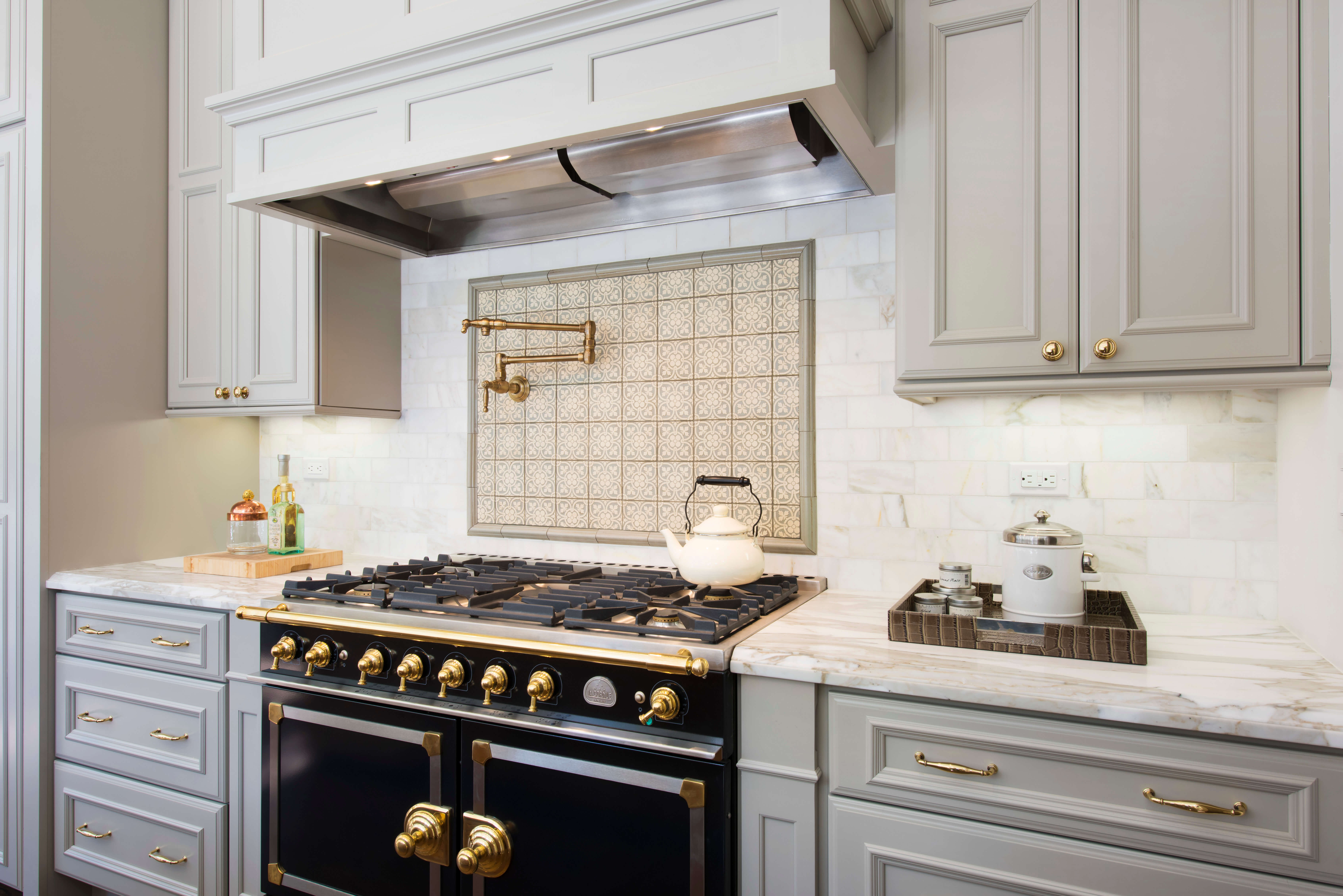 Beautiful slide-in range with double ovens. Dura Supreme kitchen design by Gilmans Kitchen and Bath, California.