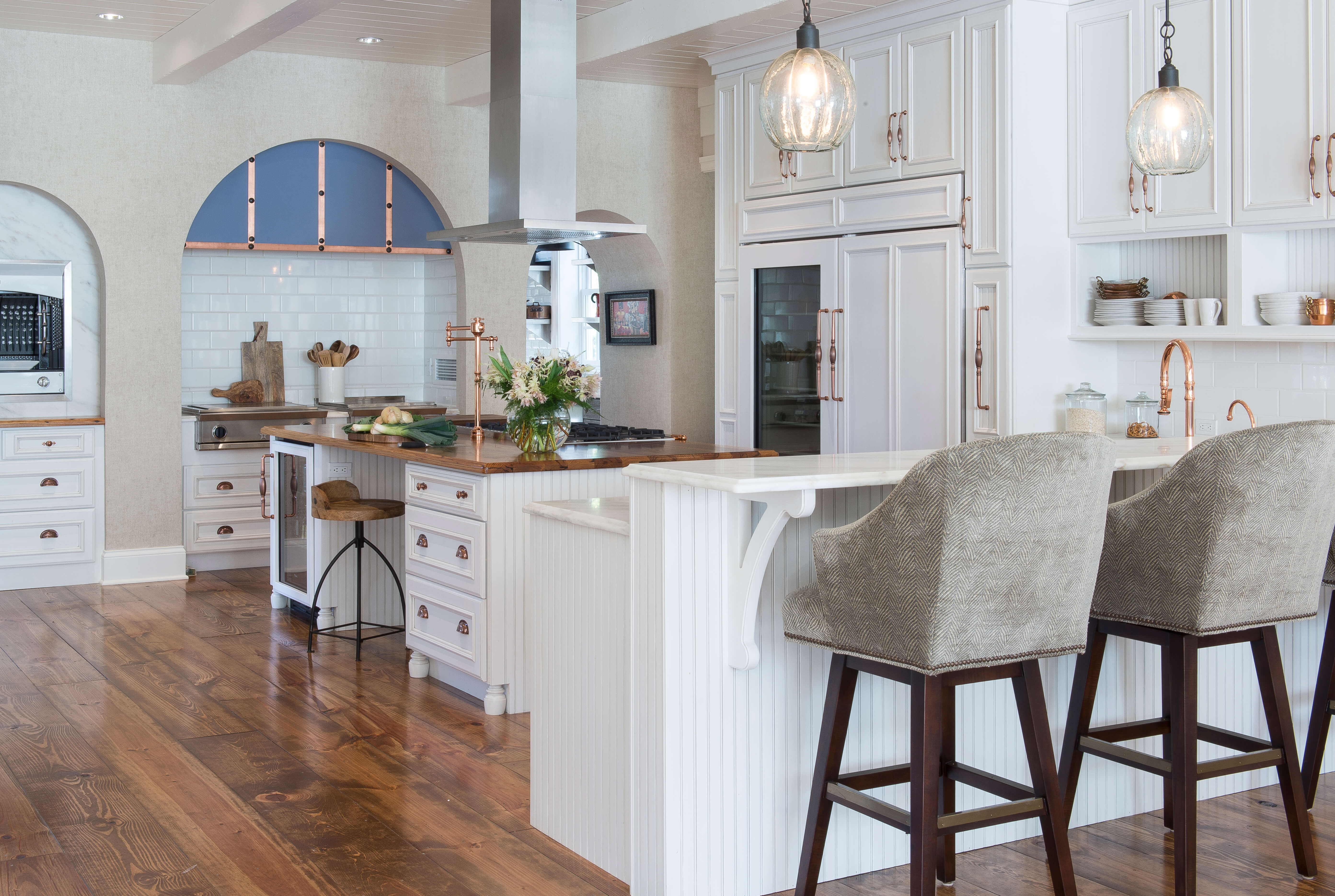 The breakfast bar has a 2-tier countertop to separate the dining space from the countertop near the sink for food prep.